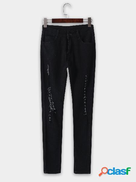 Pantalones vaqueros de talle bajo con detalles aleatorios negros