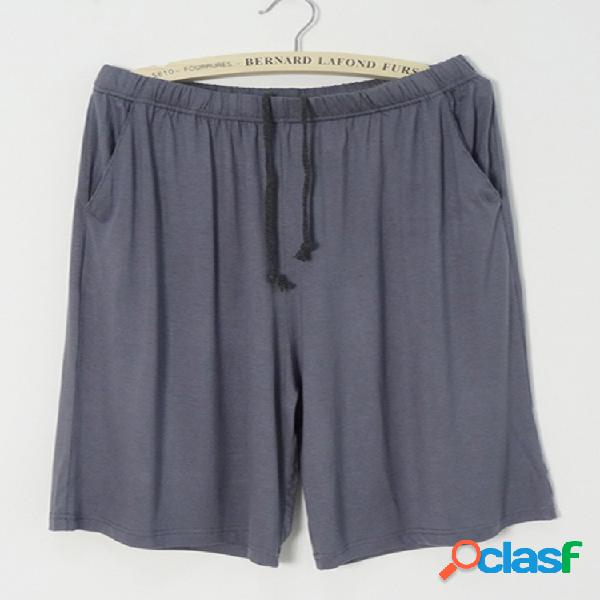 Pantalones cortos delgados sueltos sólidos informales de cintura elástica modal para hombre