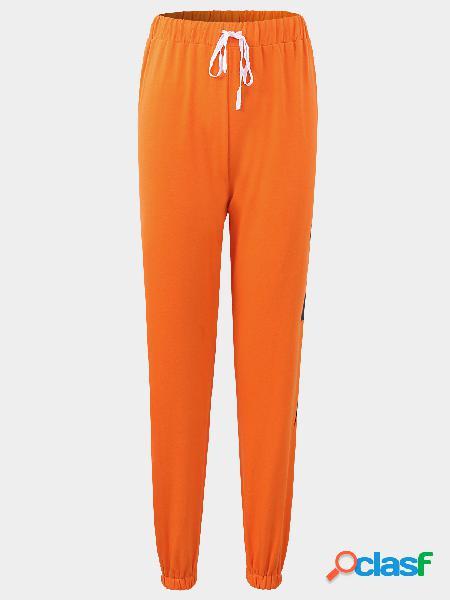 Pantalones vaqueros flacos de la cintura del lazo activo en naranja