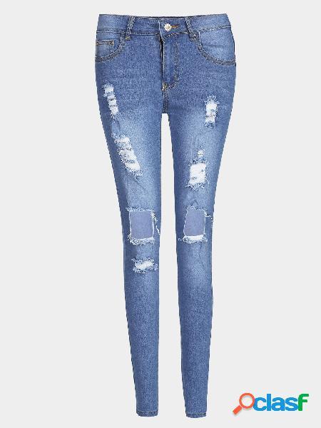 Jeans rasgados de cintura alta