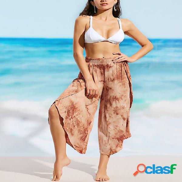 Pantalones de playa de cintura elástica con diseño de abertura con estampado floral al azar