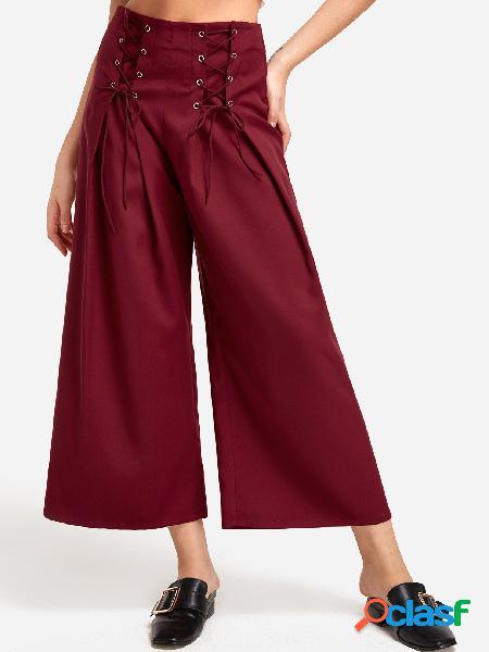 Pantalones anchos de talle medio con cordones y diseño de cordones rojos