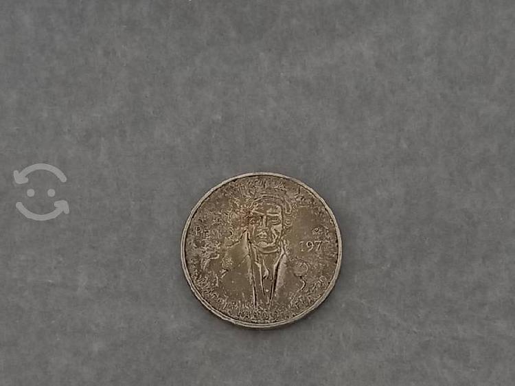 Moneda plata morelos de 100 pesos.
