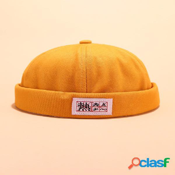 Hombre mujer sombreros sin ala de algodón de color sólido cráneo gorras con letras chinas