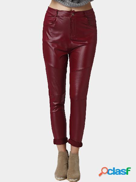 Cremallera roja y cierre de botones pantalones de cuero con dobladillo delantero