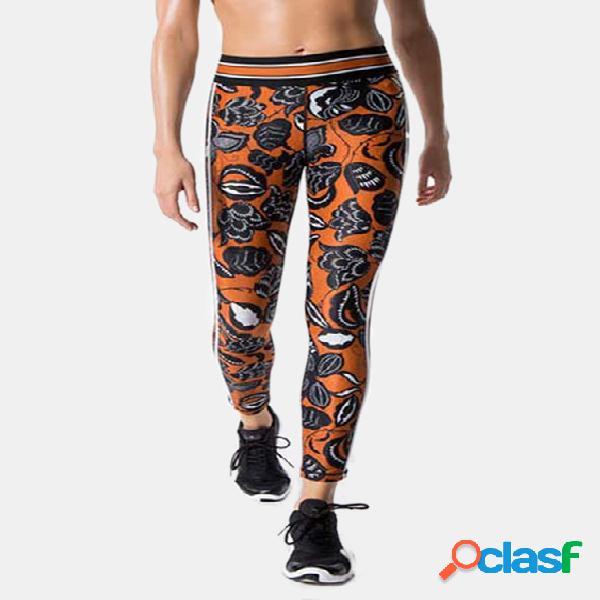 Pantalones cortos con estampado floral y cintura alta en naranja